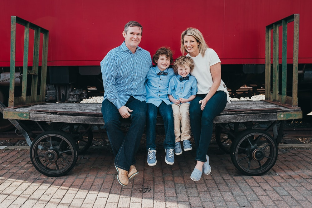 San Diego Family Photography, family of four sitting on old train cart