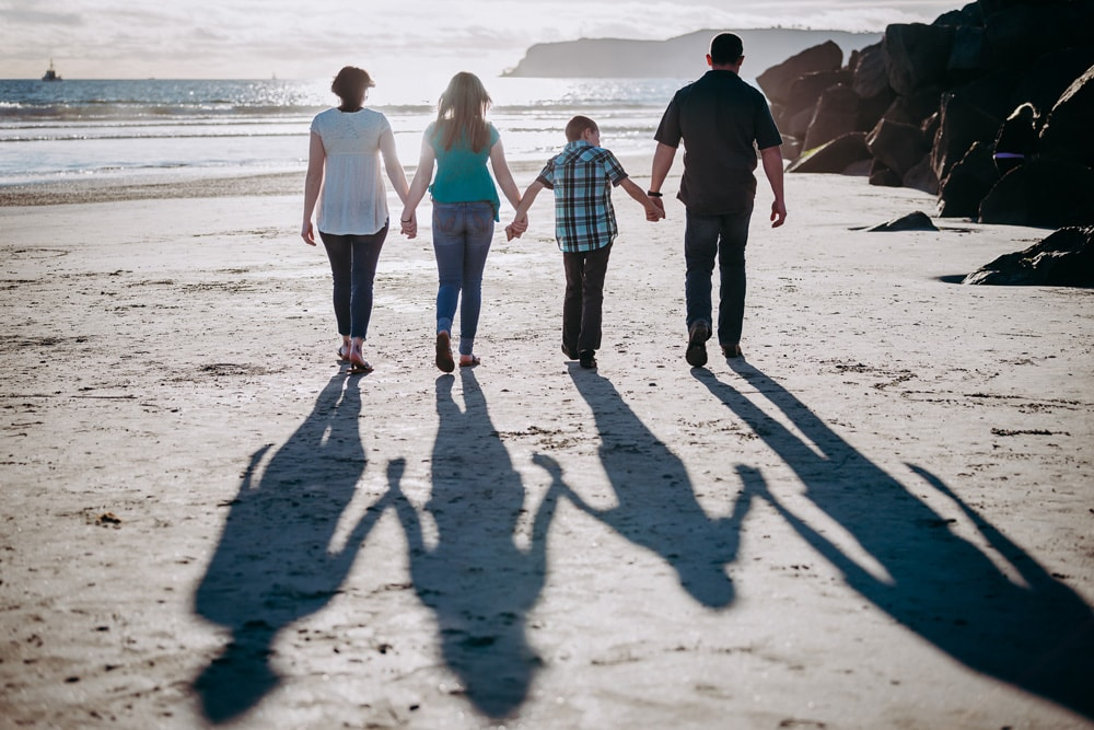 San Diego Family Photography, family at the beach with their shadows behind them