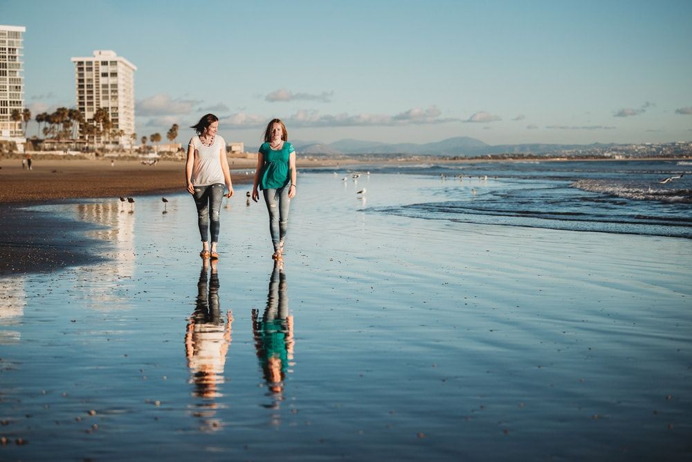 San Diego Family Photography, mother and daughter walking by the ocean together