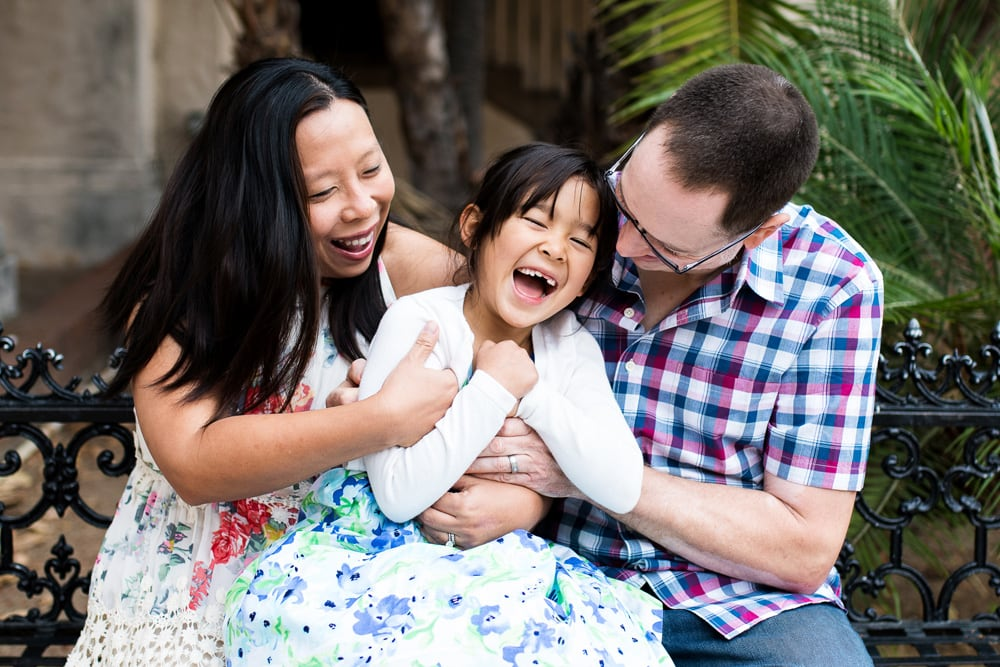 San Diego Family Photography, husband and wife tickling daughter