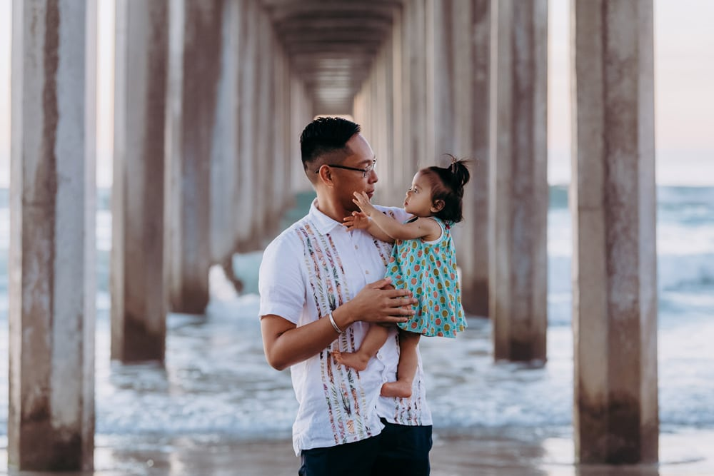 San Diego Family Photography, father and daughter under a bridge at the beach