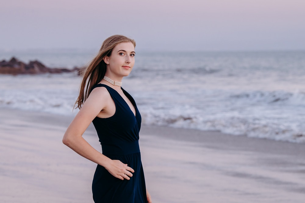 Senior Photography, girl in dark blue dress at the beach