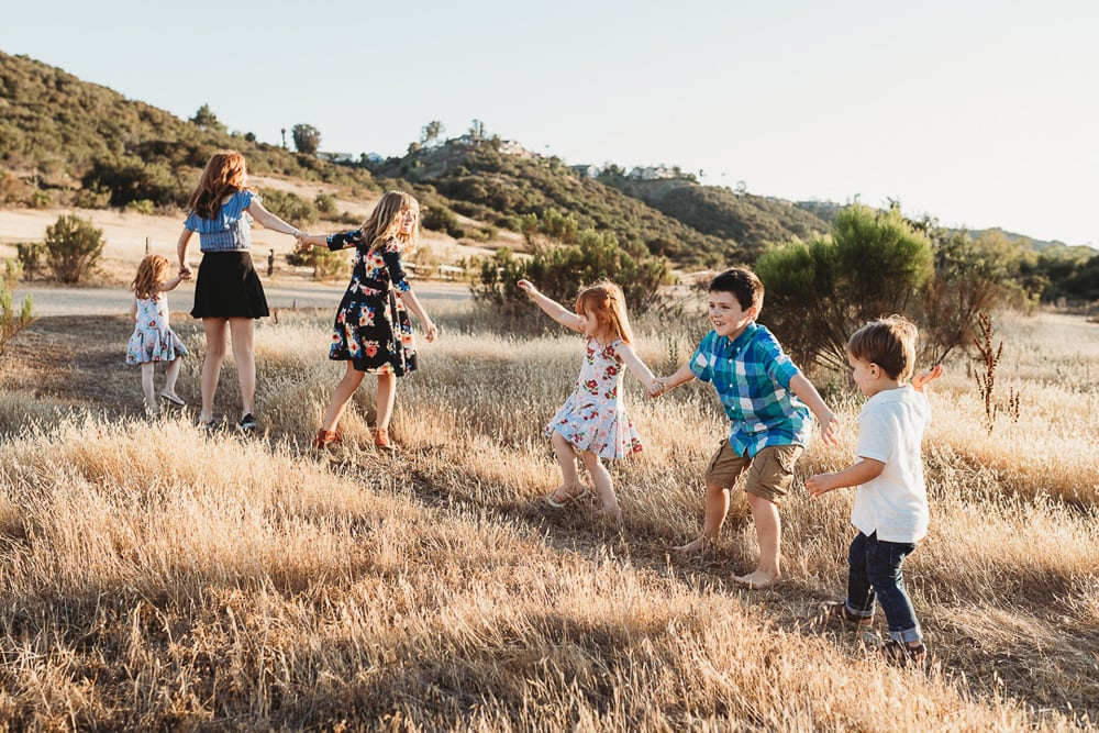 San Diego Children Photography, six siblings holding hand in tall grass