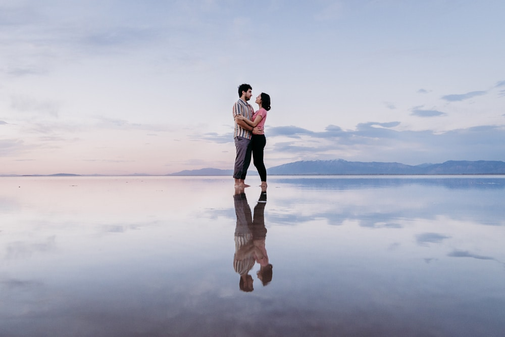 San Diego Couples Photography, couple standing in the water with their shoes off