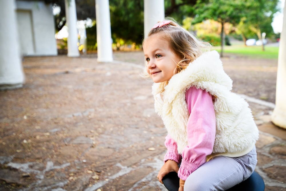 San Diego Children Photography, little girl in pink top with furry vest