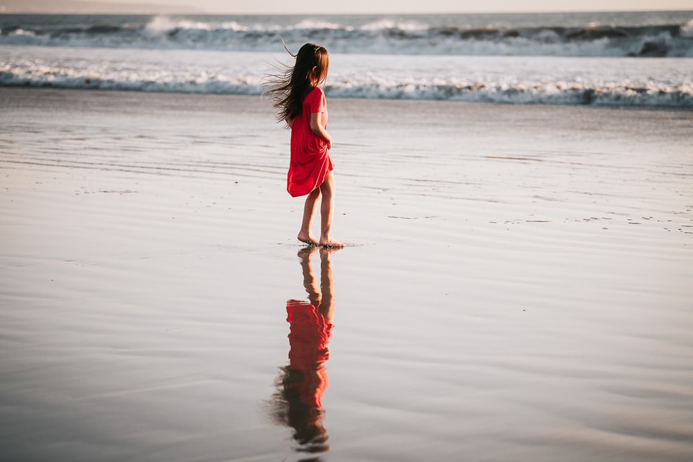 San Diego Children Photography, little girl by the beach in red dress with reflection showing