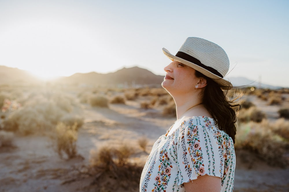Individual Portrait Photography, close up of woman in the desert wearing a hat