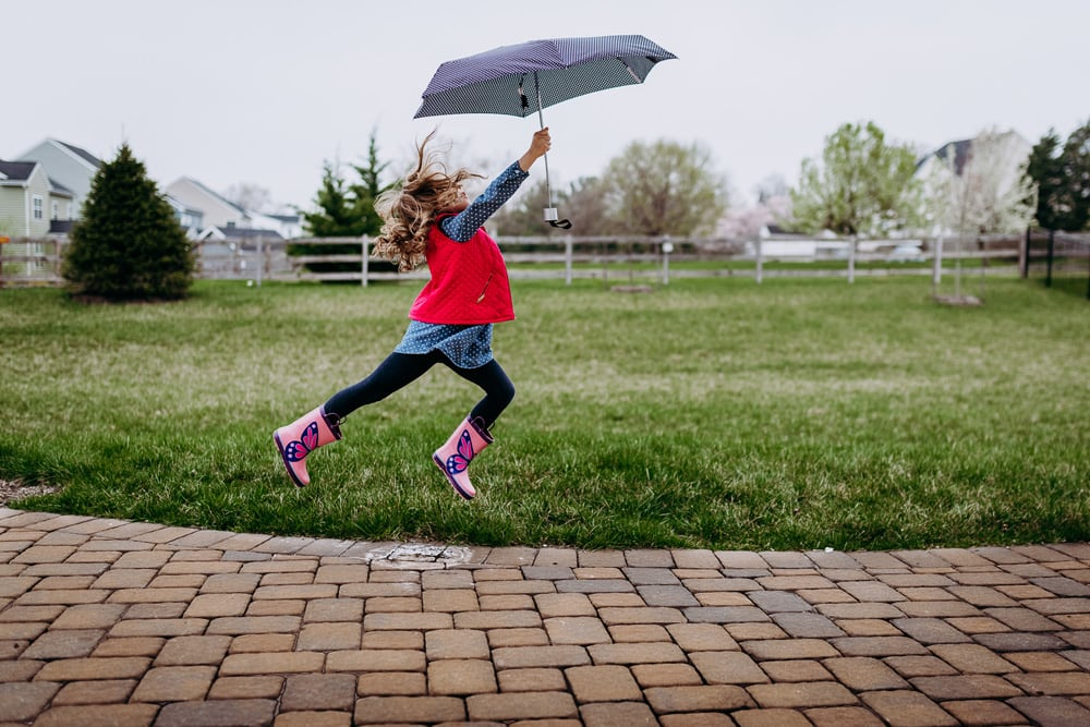 San Diego Children Photography, little girl jumping with umbrella