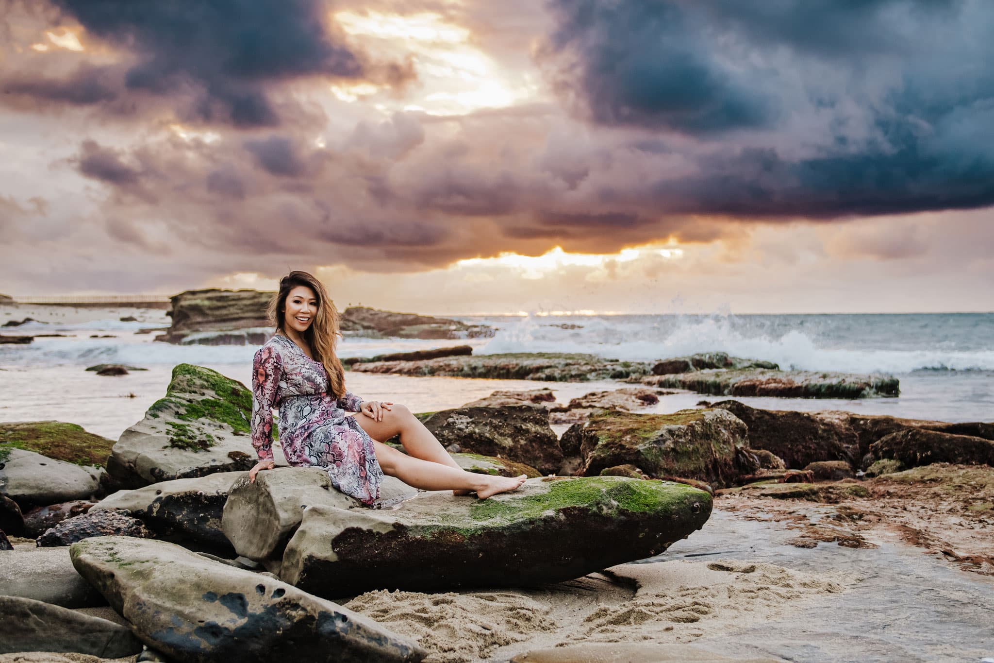 San Diego Portrait Photography, woman posing on a rock at the beach